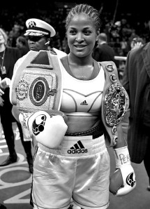 Laila Ali of the US holds her belts afte