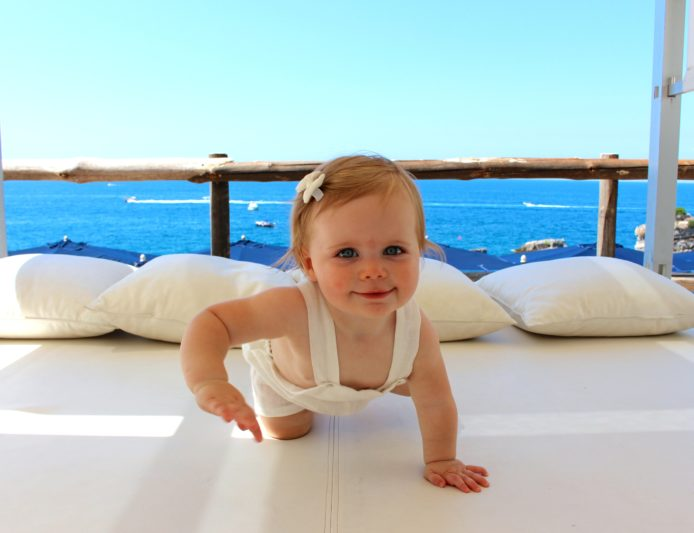 Baby Rae learning to crawl in Italy, one of the 30 countries she visited before turning one.