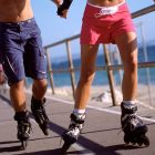 Two people on roller skates