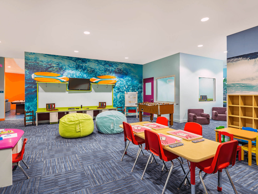 Large bright room with children's furniture