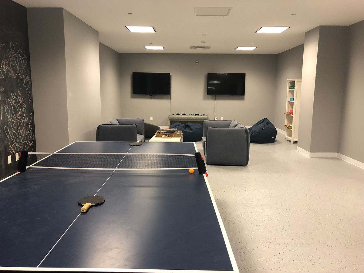 Club Wave with ping pong table cushioned chairs and two televisions