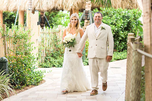 wedding couple walking along a path