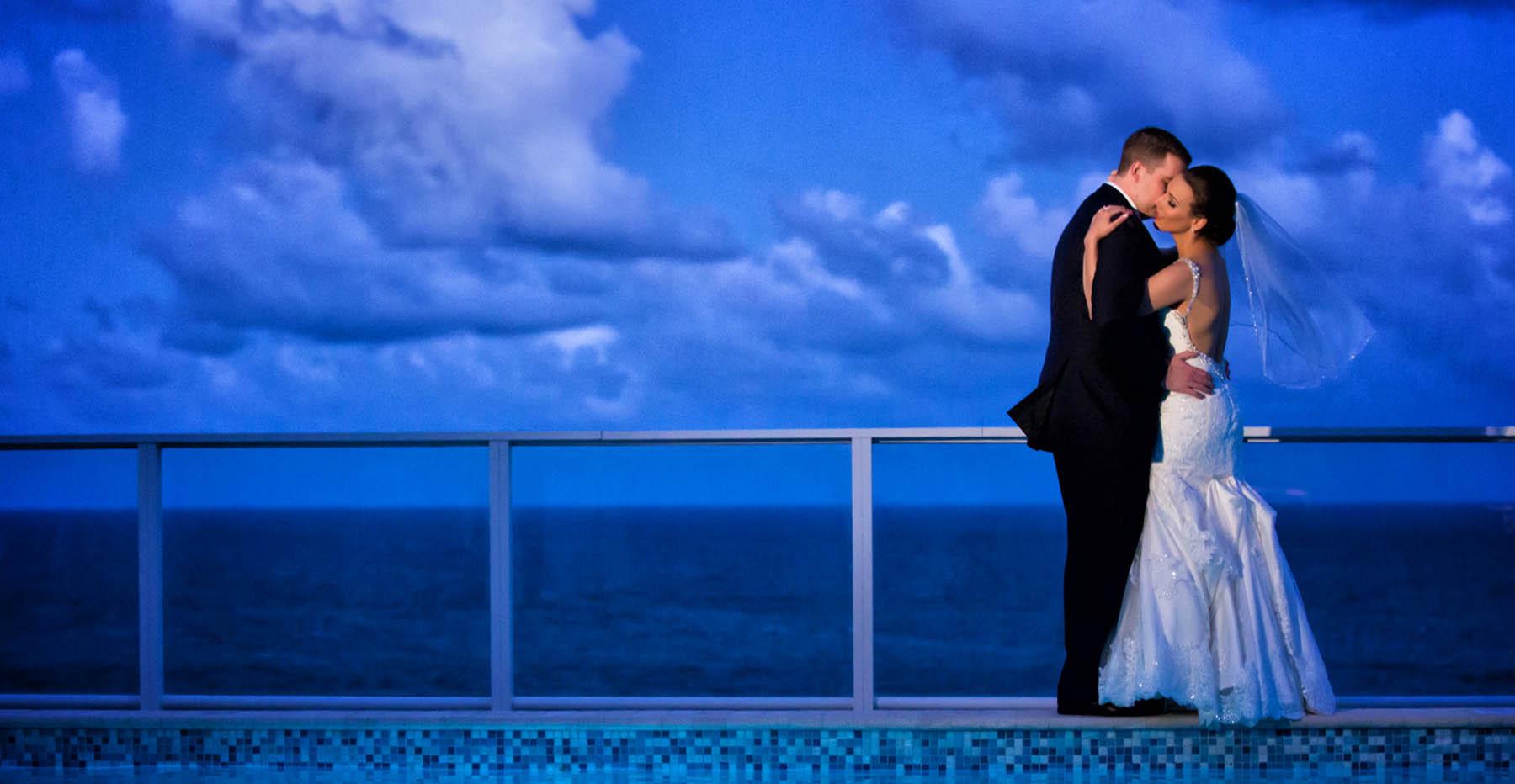 wedding couple overlooking water