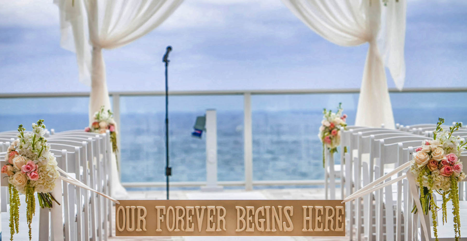wedding stage and microphone with ocean in background